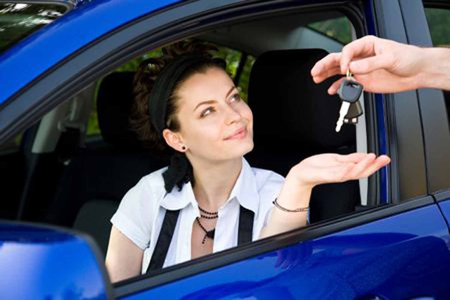Woman Sitting In Car Receiving Car Keys